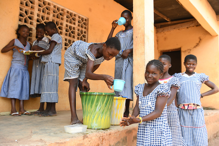 At school in Kouatoutou, Ivory Coast, 10-year-old Grohi washes her hands every day after classes and before dinner.
