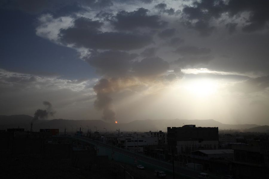 Children in conflict in Yemen, 2015: after an airstrike hit Faj Attan Mountain, above Sana'a, smoke blankets the city.