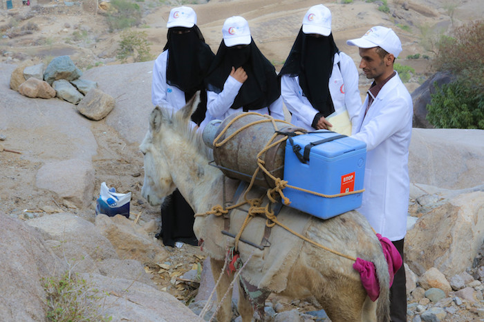 UNICEF health workers and volunteers make their way to deliver polio vaccines to the remote village of Bani Mansour, Yemen, in February 2017.