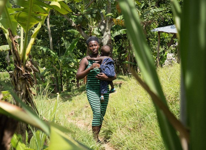 Yolette, 34, with her son Jean, near their home in Lasahobas, Haiti, where progress is being made in the fight against cholera.