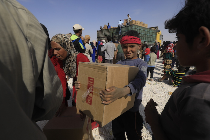Families who fled to Areesheh camp from fighting in northeast Syria were sleeping in the open without tents or blankets when UNICEF distributed 2,000 winter clothing kits to help them withstand dropping temperatures.