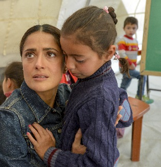 UNICEF supporter and CHIME FOR CHANGE campaign Co-Founder Salma Hayek meets with Syrian refugee children and aid workers in April 2015