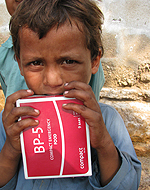 A child holds his ration of high-energy biscuits