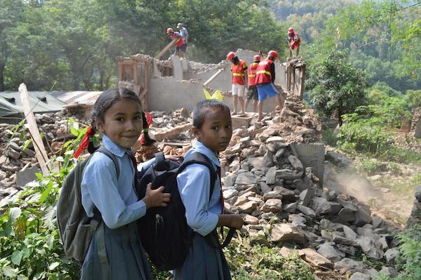 Second-graders Rushma Shrestha and Rakshya Adhikari head back to school in Gorkha.