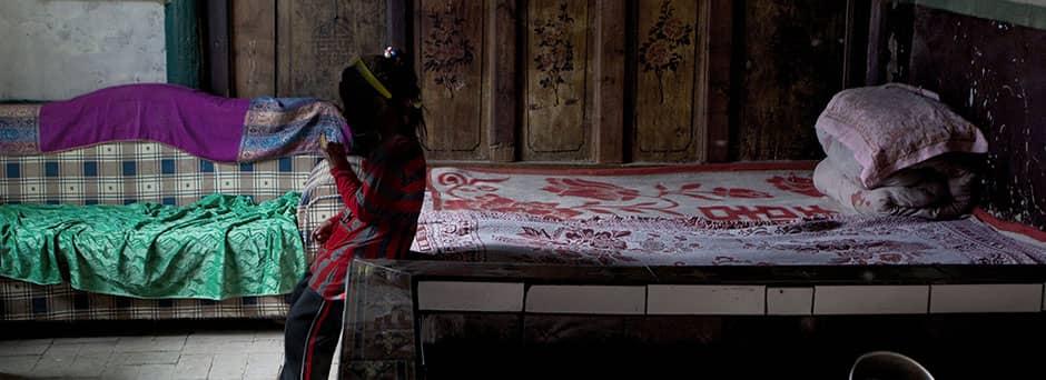Child in dark room