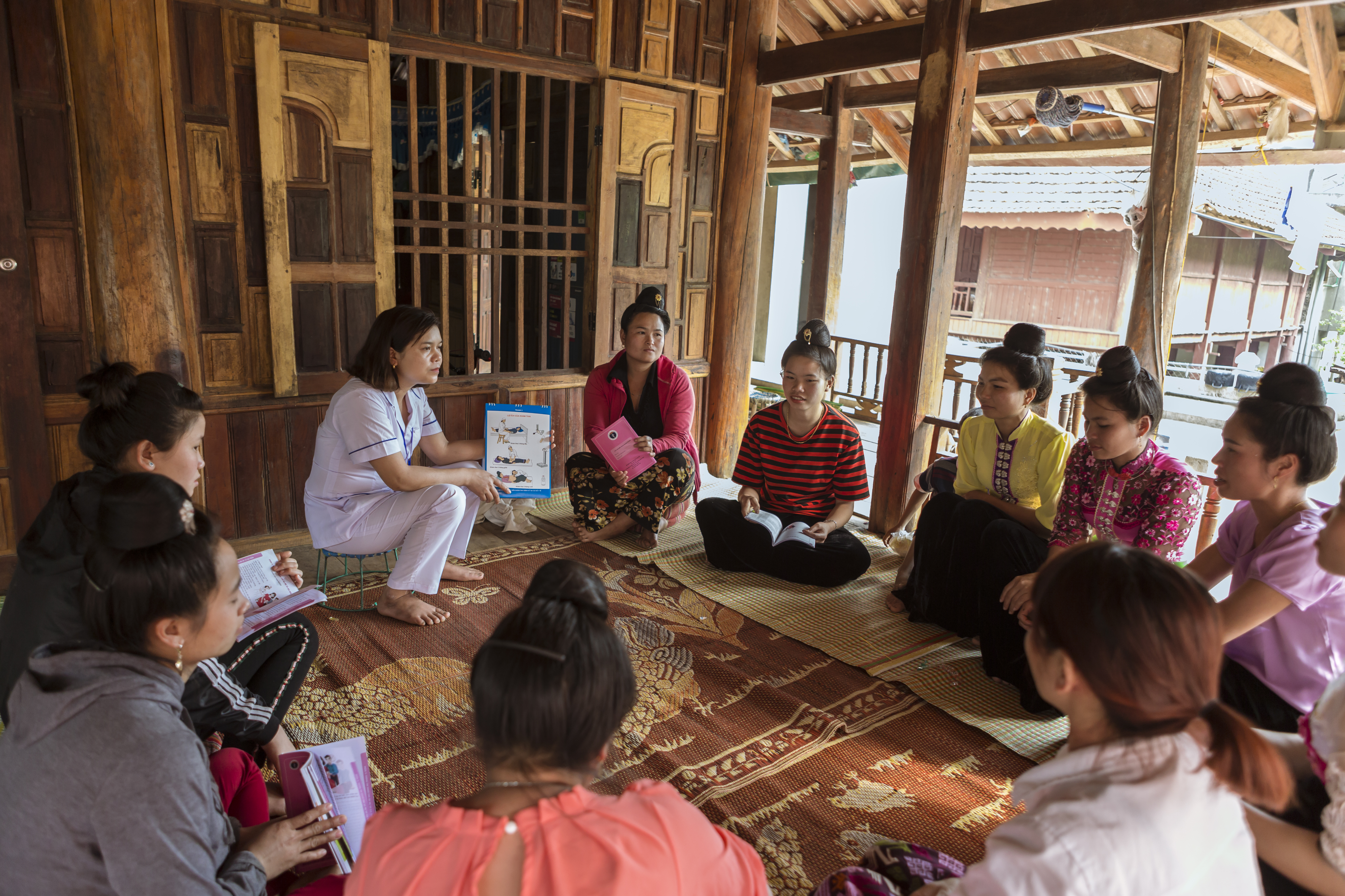 Chief nurse Lo Thi Tinh (left) has worked for over ten years at the Na Son commune health center in Vietnam, facilitating regular community group discussions on antenatal and prenatal care for the Community Integrated Early Childhood Development Club.