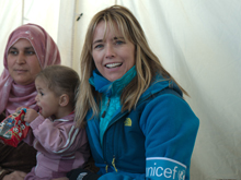 UNICEF Ambassador Tea Leoni with a young child and woman