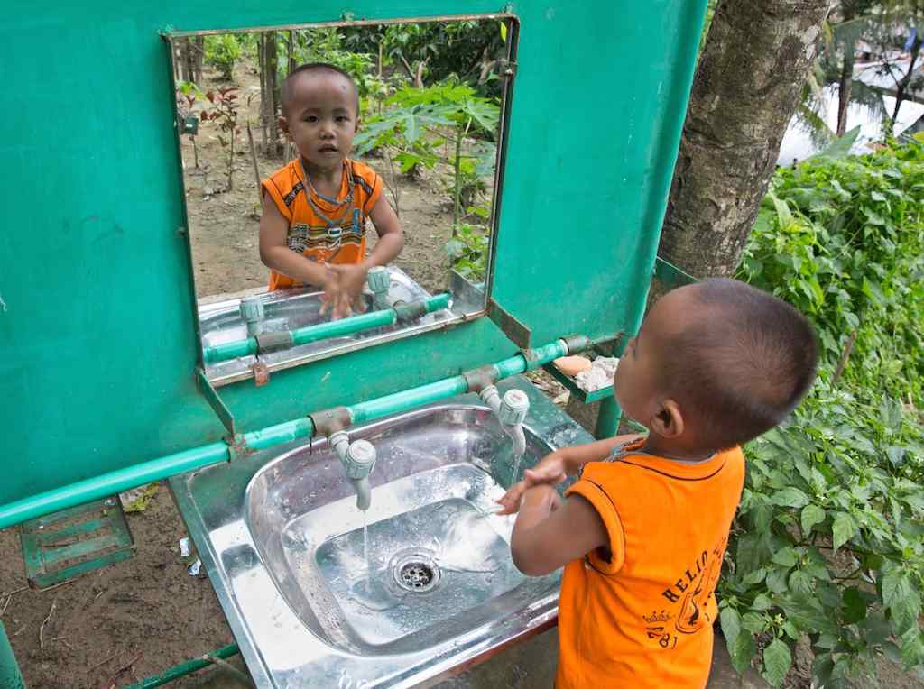 This little boy from Bangladesh is learning to wash his hands with soap and clean water at his UNICEF-supported school in the Chittagong region. It's a habit that will safeguard his health for the rest of his life.