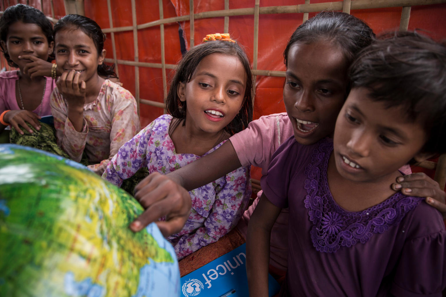 Students with School-in-a-Box materials at a Transitional Learning Center in the Uchiprang refugee camp, near Cox's Bazar, Bangladesh.