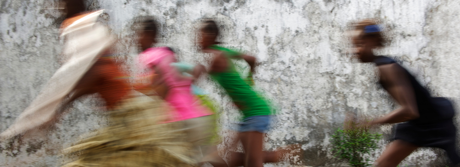 Girls run and play at a transition centre for children in contact with the law