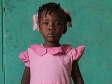 On 3 May, a small girl stands in the health centre in the village of Savane Cabrit in the West Department of Haiti. She is waiting to be vaccinated by staff from an immunization team from the nearby town of Ganthier.