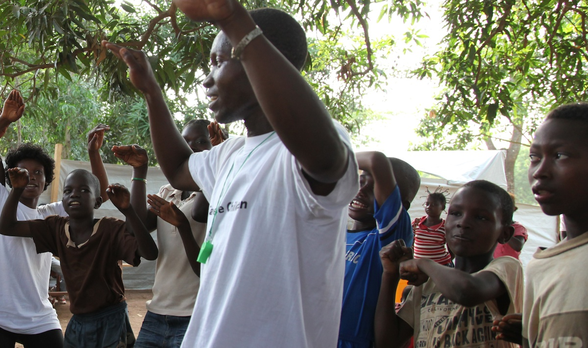 Children play and dance at a UNICEF-supported child-friendly space in Bangui, Central African Republic.