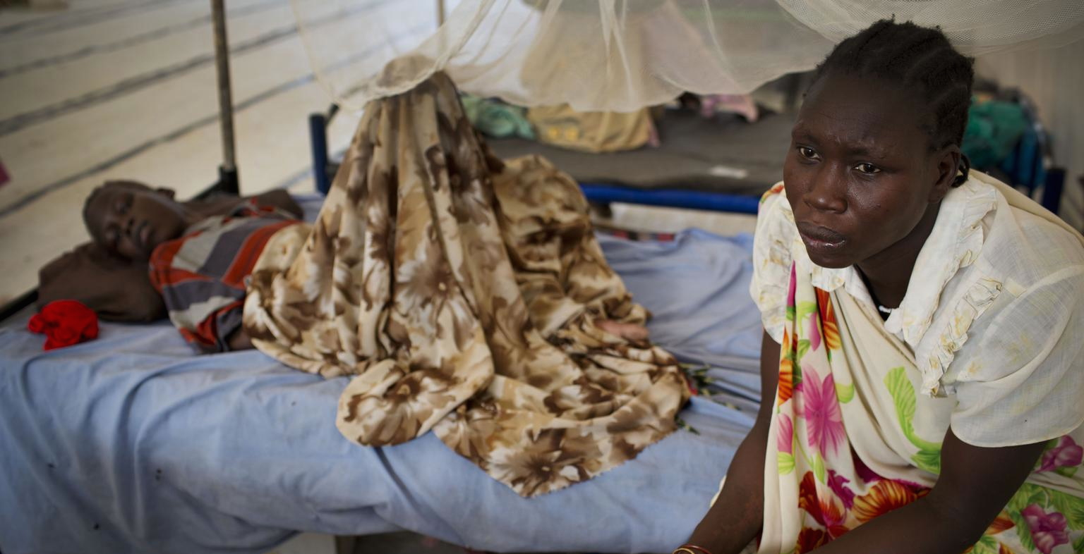 A displaced woman sits at her daughter's bedside in a UNICEF-supported emergency medical center in Malakal, South Sudan.
