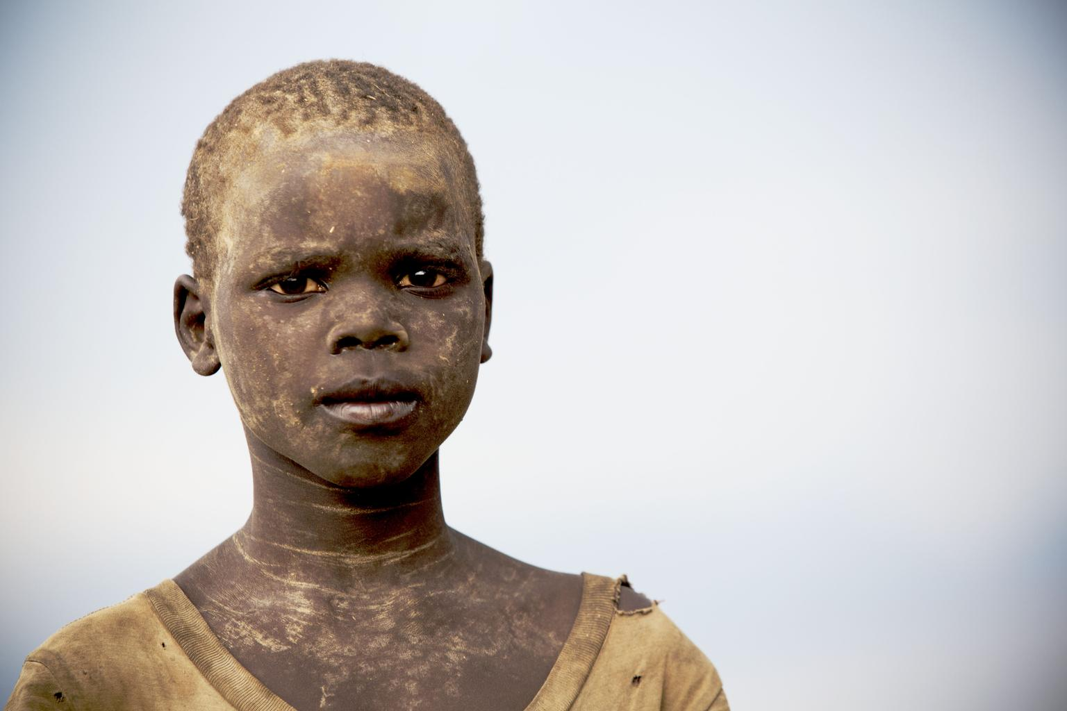 Mathiang, 10, stands at a food distribution site in the town of Mingkaman, South Sudan.