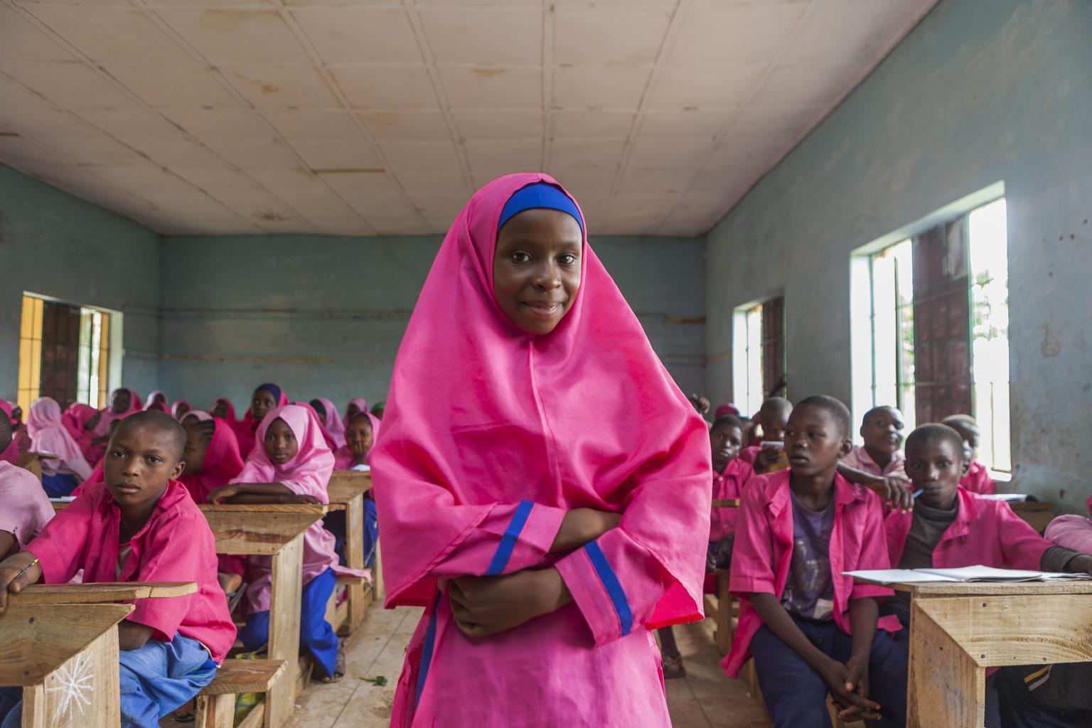 Nailatu Al-Quasm, 12, stands in her classroom at the UNICEF-supported Gyezmo primary school in the town of Toro, Nigeria.
