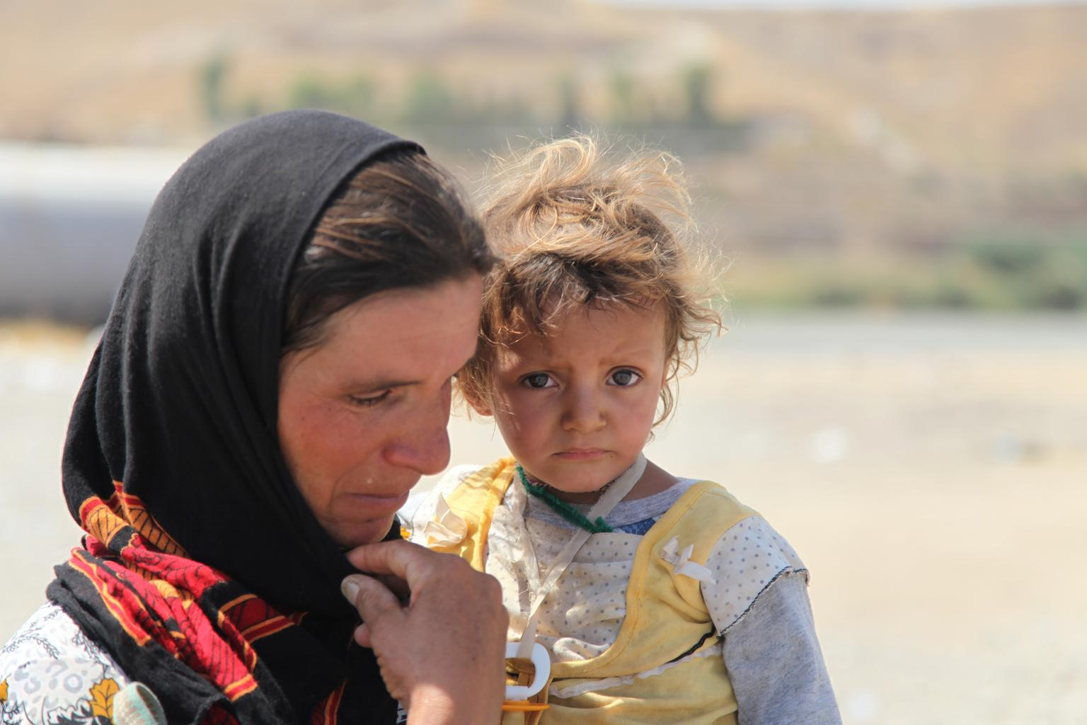 A Yazidi woman who fled Sinjar Mountain re-enters Iraq from Syria at a border crossing in Peshkhabour, Dohuk Governorate. © UNICEF/NYHQ2014-1247/Khuzaie