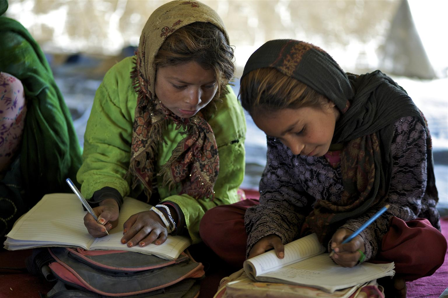 Holia (8 years old) from Jogi ethnic group, writes Dari in her textbook at UNICEF supported Mowla Ali community based school (CBS) in Khurasan neighbourhood in the city of Mazar in northern Afghanistan.