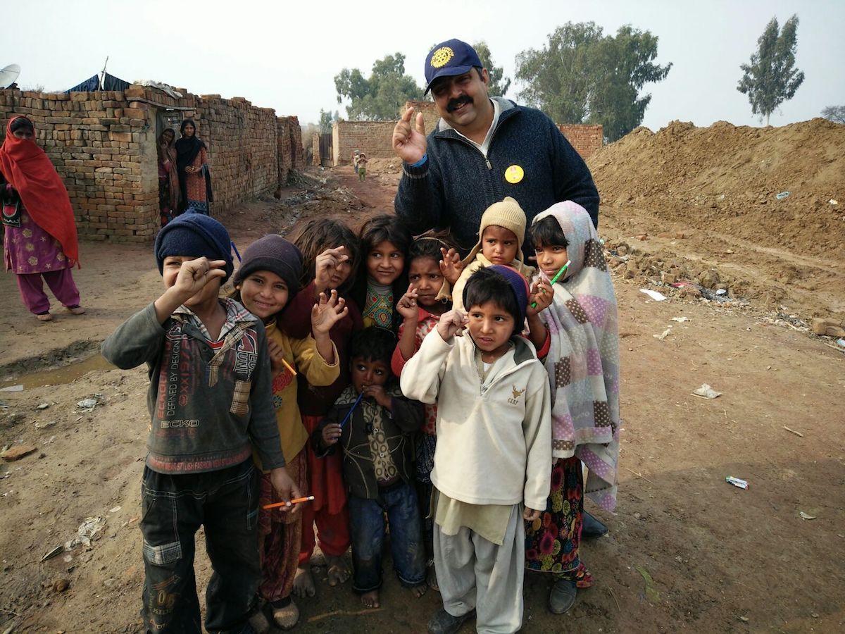 AG Nosherwan Khan with children in rural Pakistan, 2017.