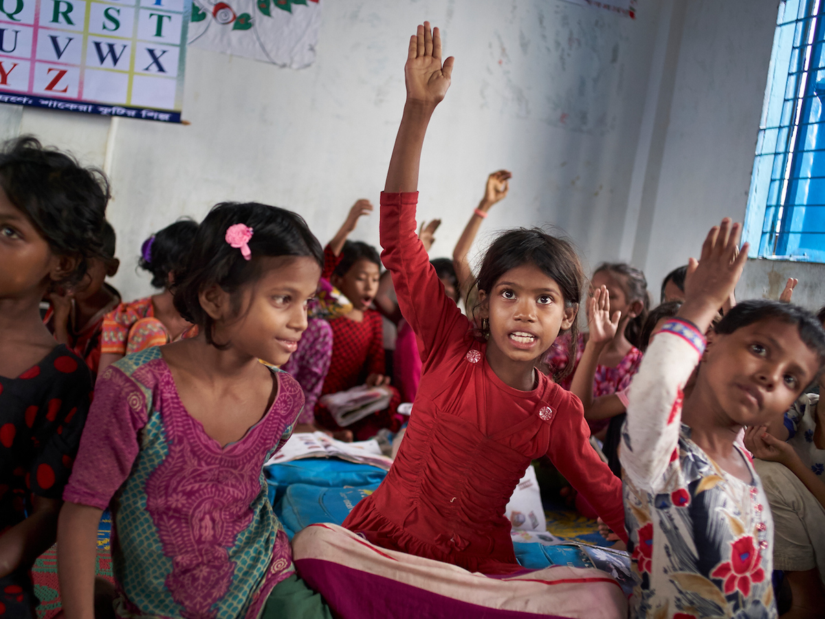 """Eight-year-old Rohingya refugee Yasmin and other students at the """"Prajapatti"""" (Butterfly) UNICEF learning center in the Kutupalong makeshift refugee settlement in Cox's Bazar, Bangladesh."""
