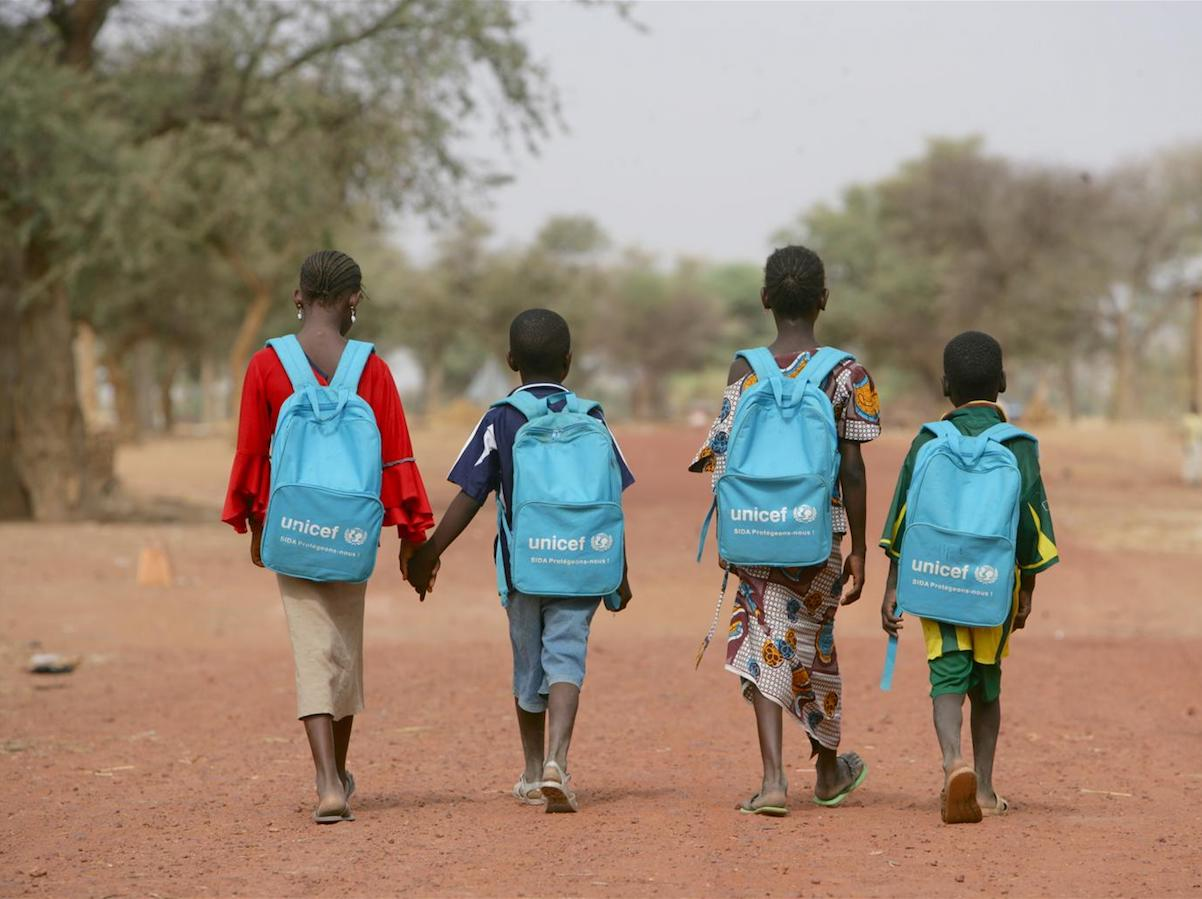 Children on their way home after a day in a child-friendly school in Mougna, Dienne District, central Mali. UNICEF provides each student with a blue backpack filled with school supplies like pens, pencils and rulers.