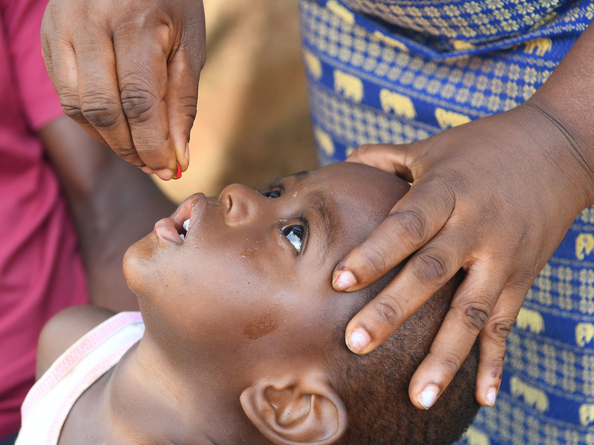 Gered, 18 months old, being vaccinated against polio during a UNICEF mobile vaccination campaign in the village of Dibobly, Côte d'Ivoire.
