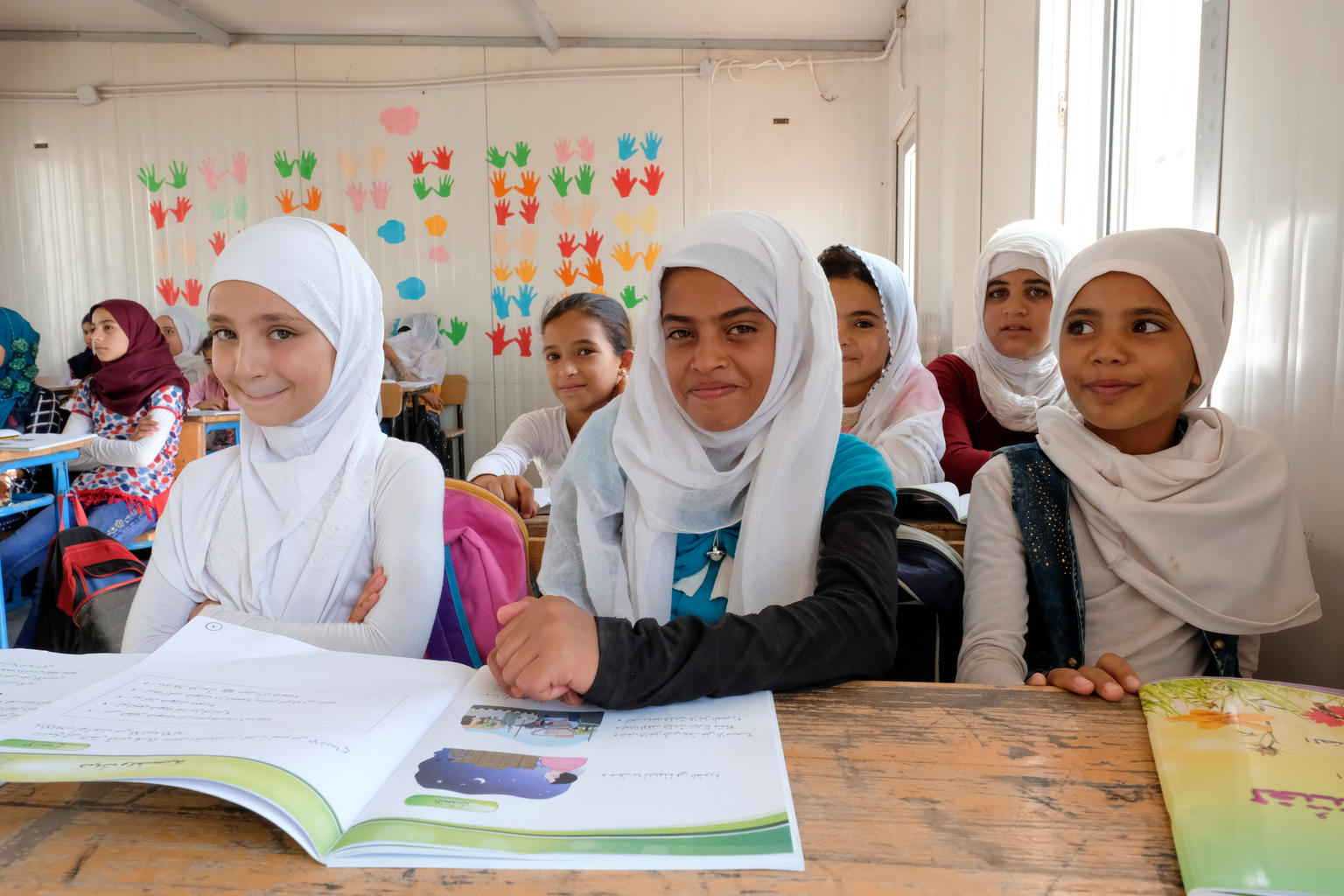 On 11 September 2017, Syrian refugee students in the fourth grade smile during a visit by UNICEF Goodwill Ambassador Priyanka Chopra to their school in Za'atari refugee camp, Mafraq Governorate, Jordan.