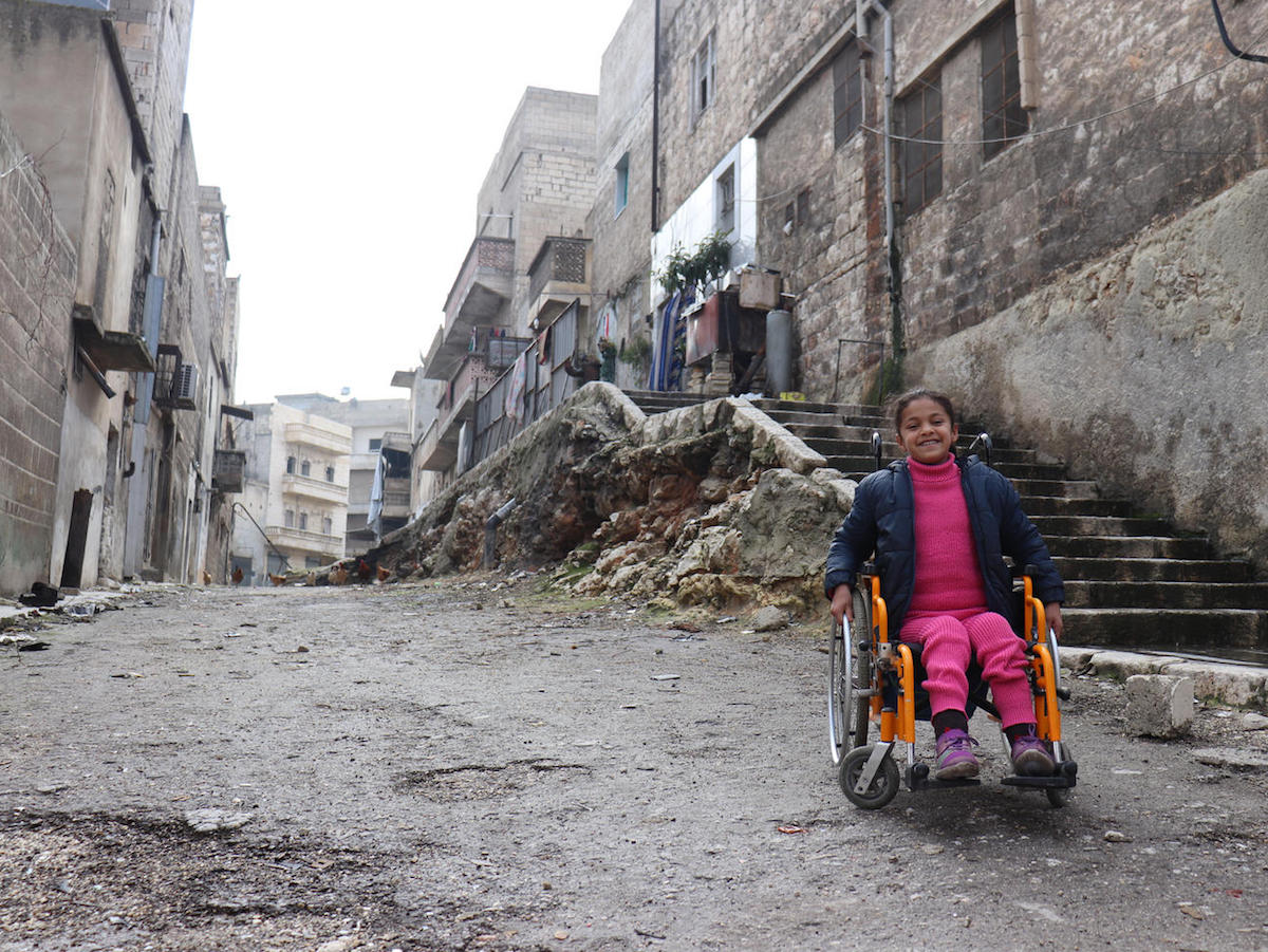 After Hanaa, 8, was paralyzed by an exploding bomb in Aleppo, Syria, volunteers at a UNICEF-supported Child Friendly Space helped her get back to learning and playing.