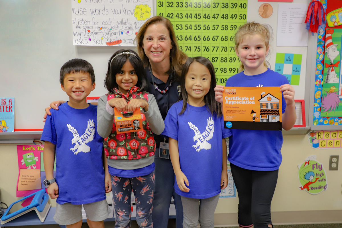 Students from Liberty Elementary with their teacher, Andrea Brogan, celebrating another successful Trick-or-Treat for UNICEF fundraising effort.