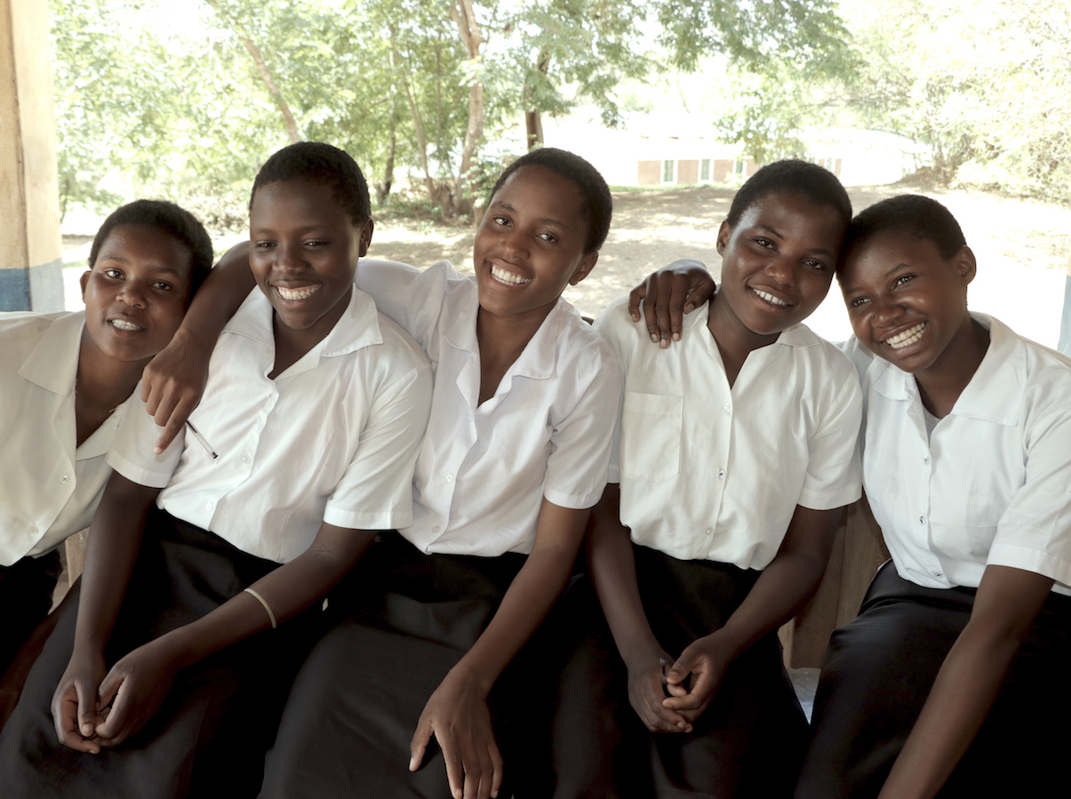 The K.I.N.D. Fund, a partnership between UNICEF and MSNBC's Lawrence O'Donnell, provides scholarships to students in Malawi like Rehema, far right.