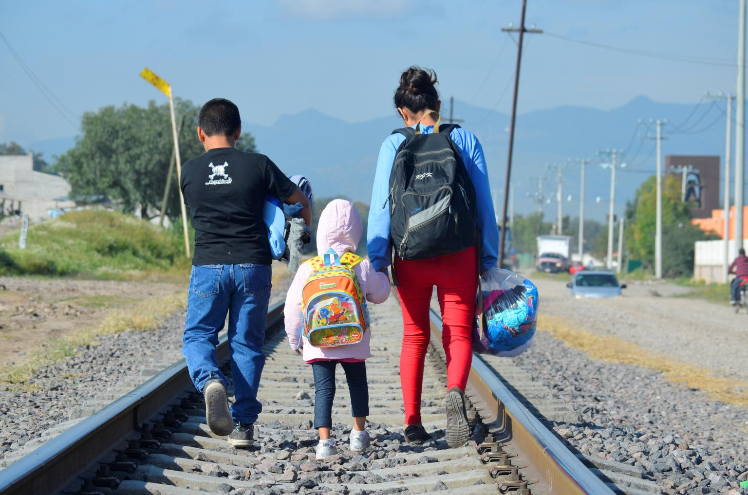 Maria, 16 (on right), from Honduras travels north with her younger siblings, expecting to cross the border to the United States to reunite with her family.