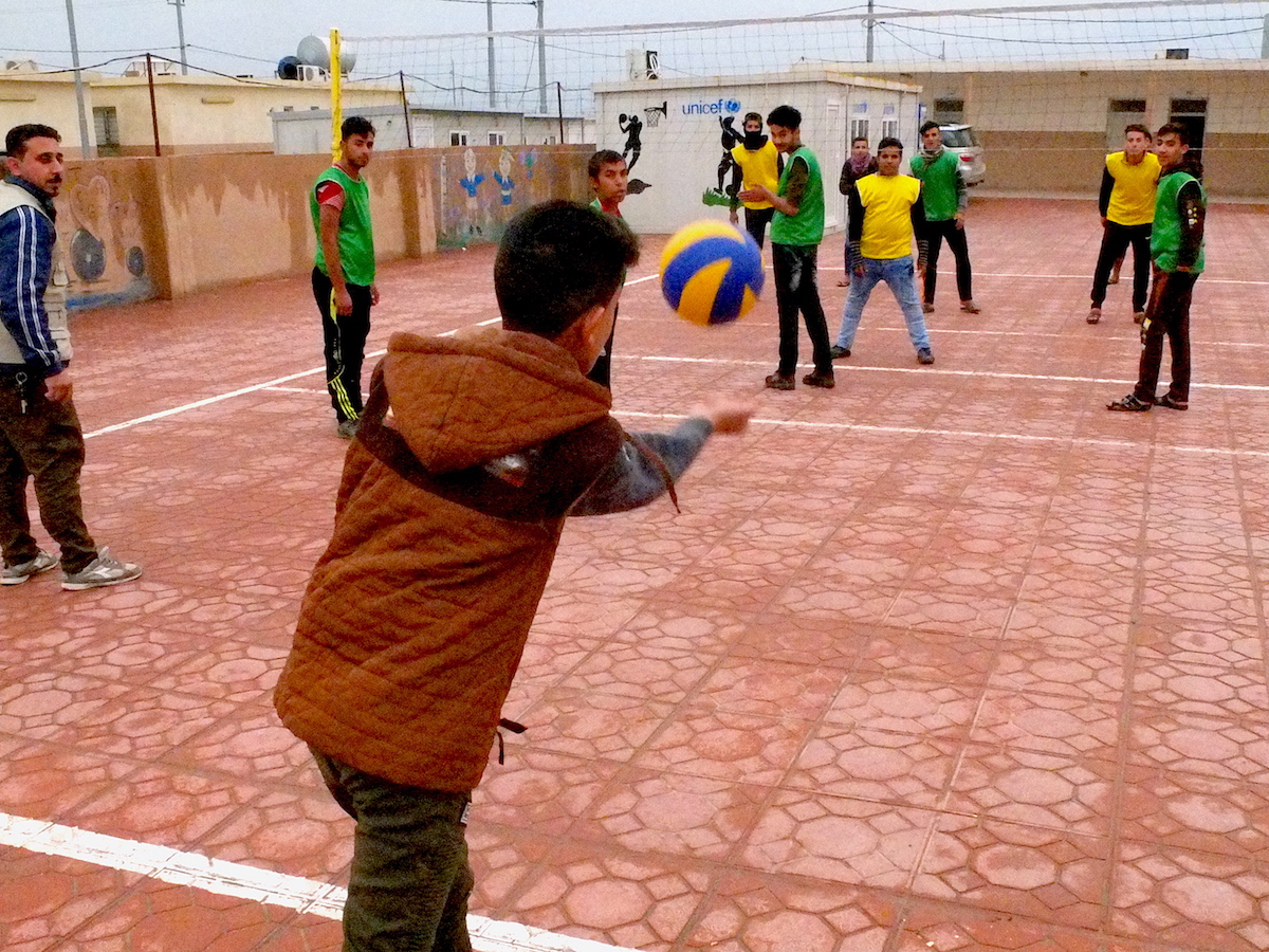 Friends play volleyball at Debaga camp in Iraq. UNICEF is working to provide counseling and education for young people affected by violence in Iraq.