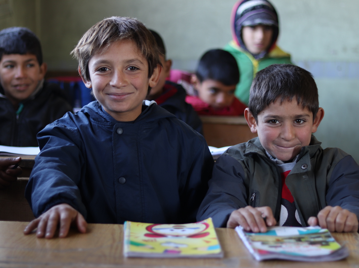 Brothers Omar, 10, and Ali, 7, attend a UNICEF-supported self-learning session in Qaramel village in northern rural Aleppo, Syria.