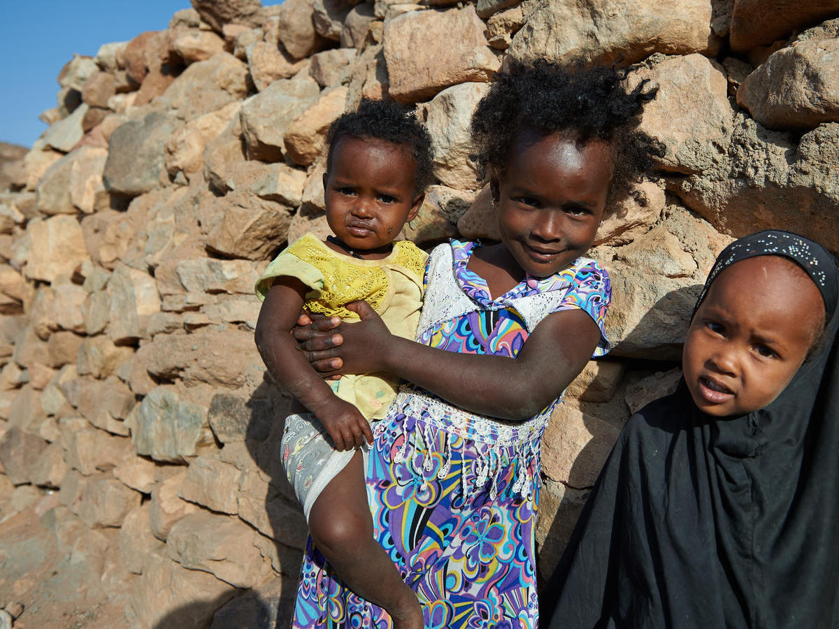 n February 2018, young girls stand outside their traditional stone home in the village of Assamo, Djibouti.