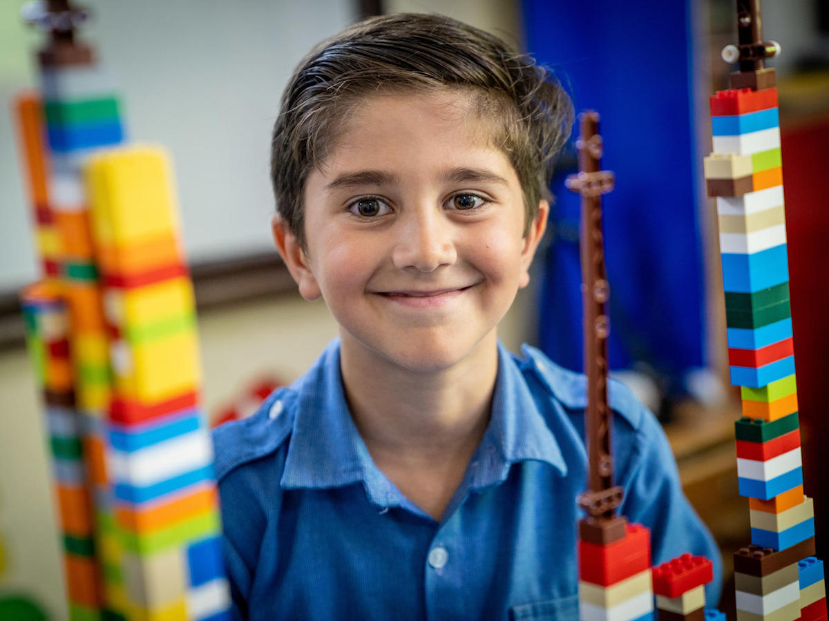 In Jordan in 2018, a Syrian refugee shows off his LEGO building skills as part of the Learning Through Play partnership between UNICEF and LEGO Foundation.