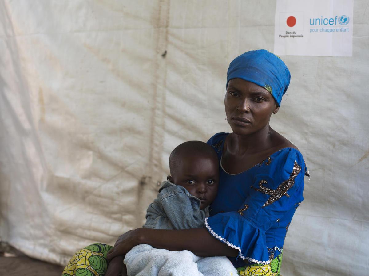 Zuliya Nboyo brings her son, Kayoka, 2. to a community health worker at an Internally Displaced Persons camp in Kalemi, Tanganyika province, Democratic Republic of Congo in November 2018.