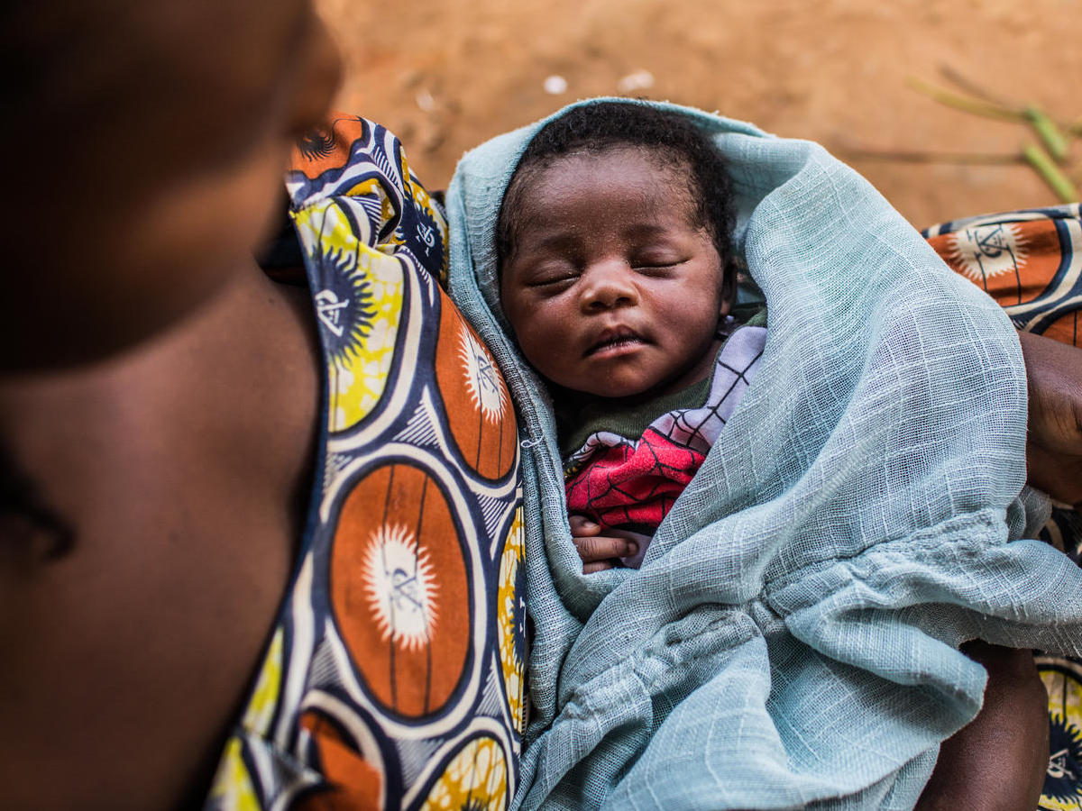 Mujinga, 30, holds her 2-week-old daughter, Francine, in Kananga, Kasai-Occidental Province, Democratic Republic of Congo in March 2019.