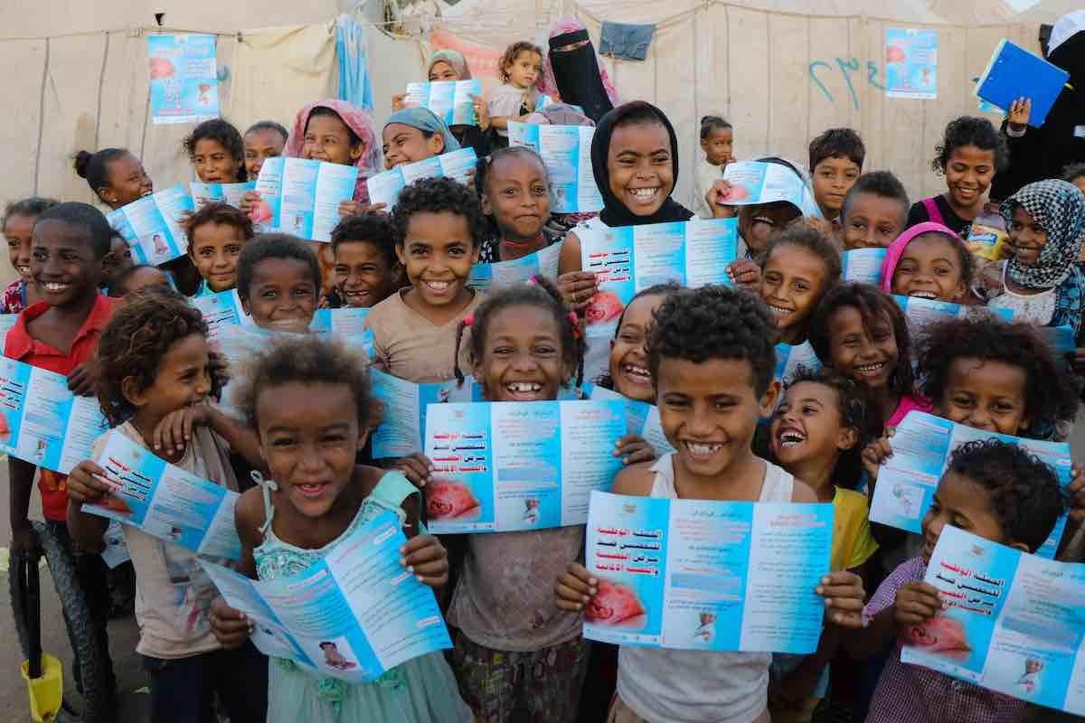 A group of children in Aden, Yemen read brochures about the Measles and Rubella vaccine they are about to receive on 9 February 2019. Following a measles outbreak of more than 6,000 cases in 2018, UNICEF and partners stepped up efforts to ensure all child