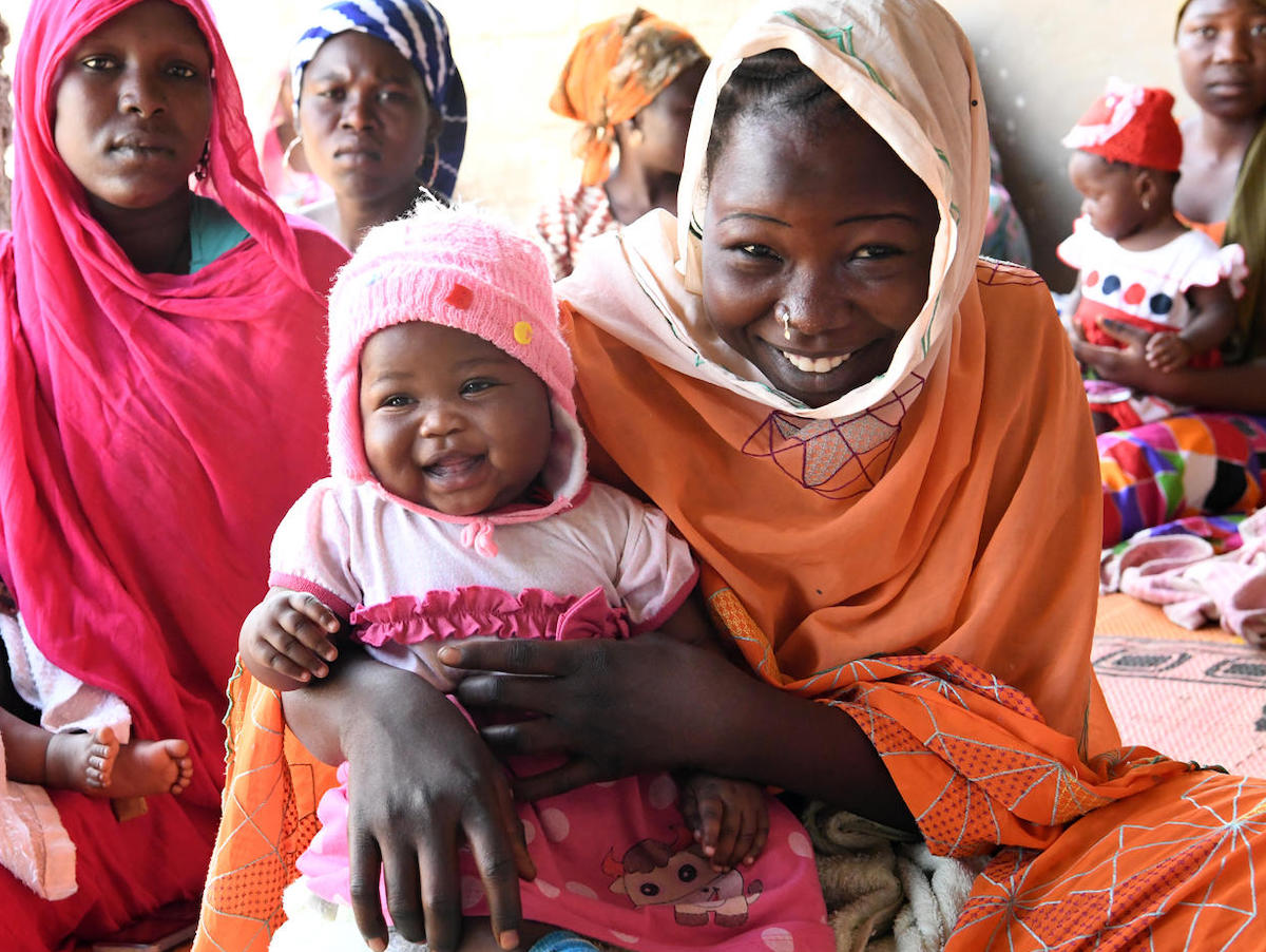 Mothers and babies wait to be vaccinated at the UNICEF-supported health center in Ambatta, a suburb of Ndjamena, the capital of Chad, in 2019.