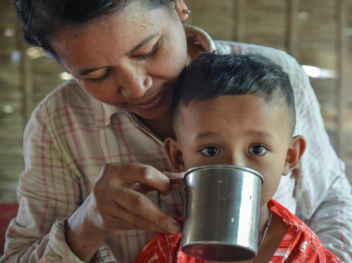 In Cambodia's Kompong Cham province, Ven Thuy, 38, and her child have safe, clean water to drink, thanks to the Kampong Chamlong Water Supply utility's partnership with UNICEF.