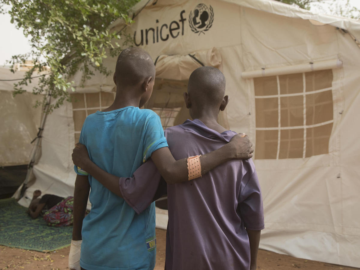 Two injured children outside a UNICEF tent at the regional hospital in Mopti, Mali, April 2019.