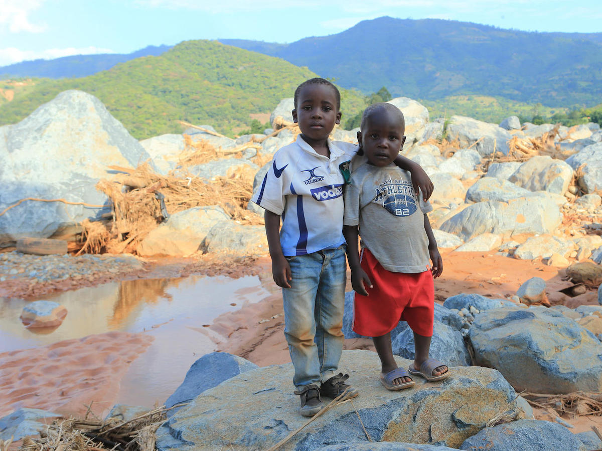 Brothers Anesu (left) and Future near the spot where their house was swept away when Cyclone Idai hit Zimbabwe in March 2019.