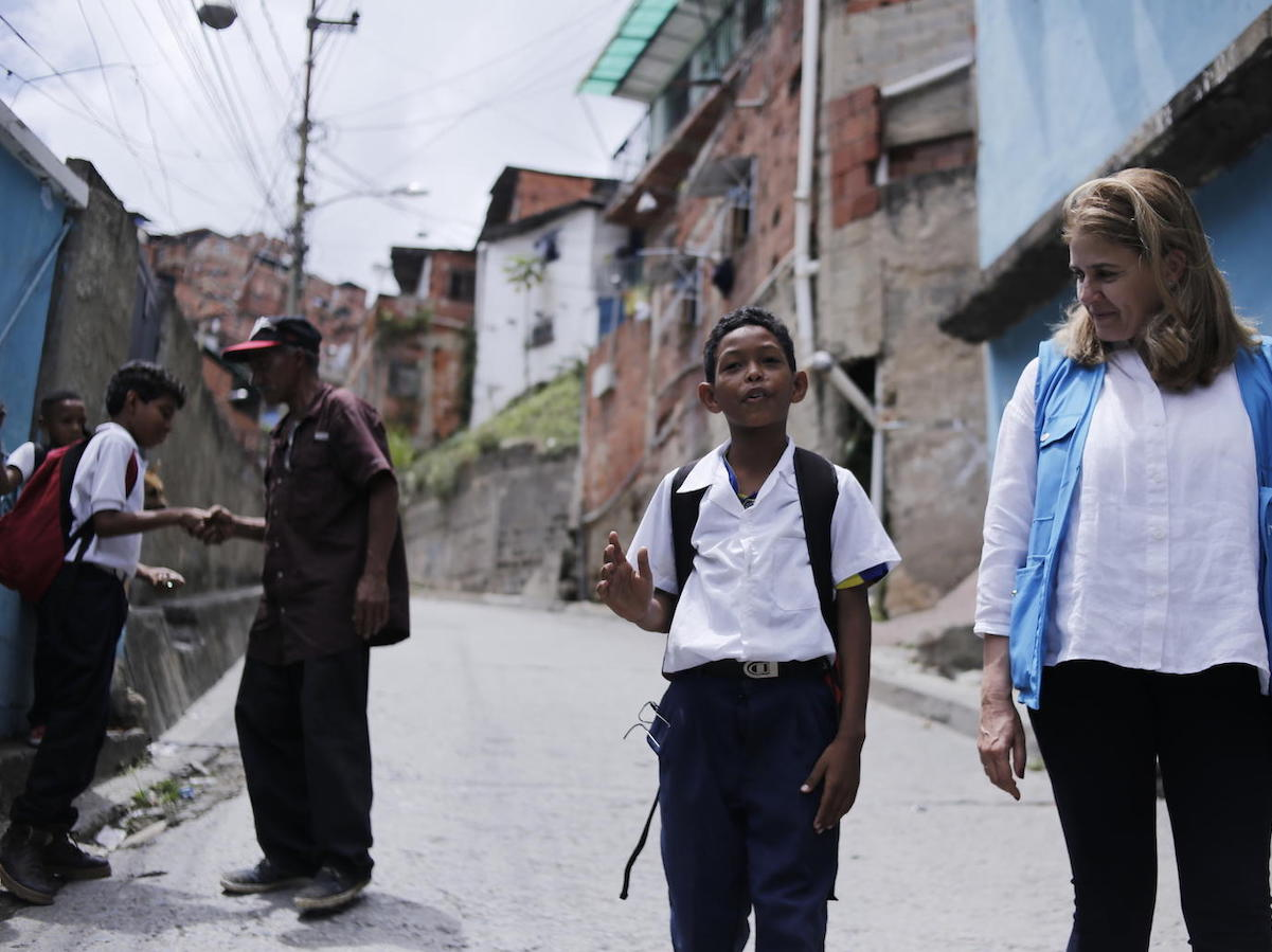 On June 4, 2019, 9-year-old student Wilker speaks with UNICEF Director of Communications Paloma Escudero in Petare, on the outskirts of Caracas, Venezuela.