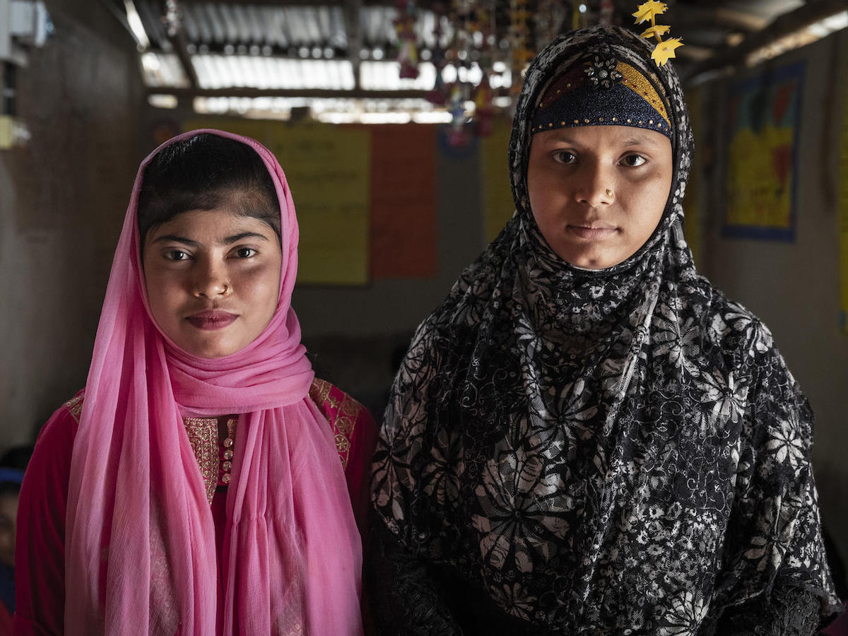 Yasmin (left), 12, a Bangladeshi national, and Showkat, 15, a Rohingya refugee, both attend a UNICEF-supported adolescent club in Lambasia refugee camp, Cox's Bazar, Bangladesh on 24 June 2019.