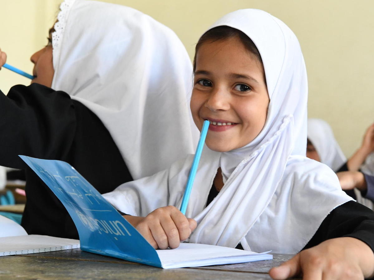 Children at the Bibi Amina Girls High School in Panjshir, a province in the North of Afghanistan, are excited with their new UNICEF school kits.
