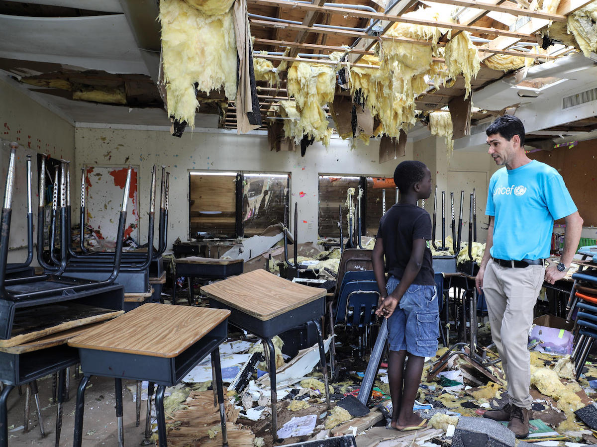 On 7 September 2019, in Marsh Harbour, Abaco Island, Bahamas. In the aftermath of Hurricane Dorian, Torres, 10, talks to UNICEF's Regional Emergency Specialist Hanoch Barlevi in his totally destroyed classroom in Central Abaco public school.