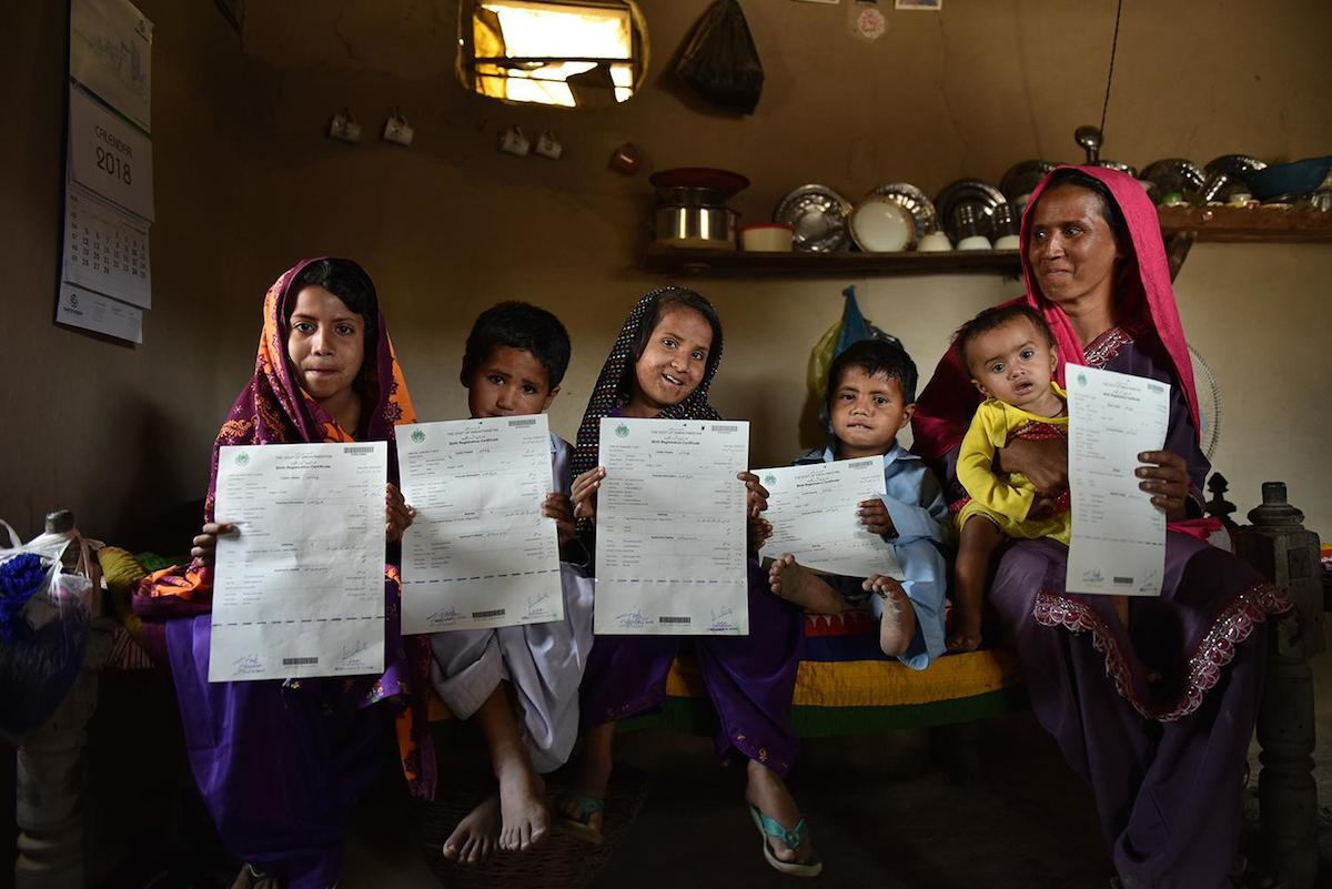 A mother in Pakistan with her five children, all of whom were recently registered and issued birth certificates using a new digital registration service launched by Telenor Pakistan in partnership with UNICEF.