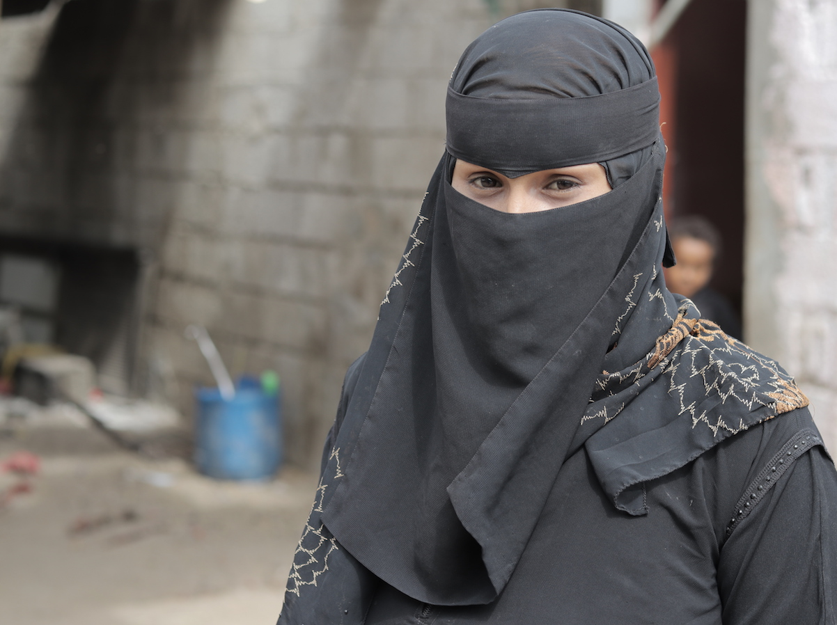 Amina was forced into early marriage at age 16. After being abused by her much older husband, she eventually returned to her parents' home in Aden, Yemen. She now runs a small business with skills she learned in a UNICEF-supported program.