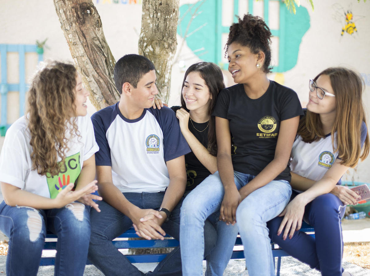 Letícia Gomes ( far left), a 15-year-old girl from a small community in north-east Brazil, speaks with a group of teenagers as part of her peer-to-peer education work through UNICEF Brazil's Selo program.