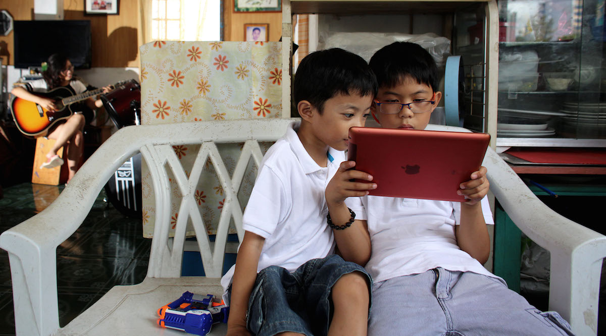 Two brothers photographed at home in Cebu, Philippines, where UNICEF works with partners to improve online safety for kids.