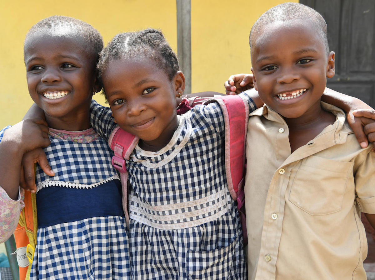 Happy friends leaving their school in Gonzagueville, a suburb of Abidjan, the capital of Côte d'Ivoire.